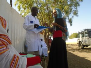 Administrative Assistant Eshraga Mohamed from IC with the Community Health Worker on site